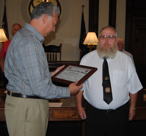 Veterans Service Officer Rich Maron, left, presents Rex Allen Rife with September's Veteran of the Month award at the county commissioners meeting Tuesday in Warsaw. A Pierceton resident, Rife is a Vietnam War veteran who served from 1969 to 1972.