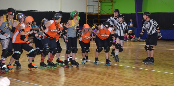 The Bone City Rollers stand ready to skate off against the Dire Skates. (Photo by Alyssa Richardson)