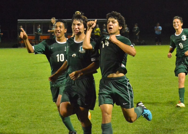 Christian Saleh (#14) runs towards the crowd with his teammates after scoring a goal in the final minute of Concord's shutout victory over Warsaw. (Photos by Nick Goralczyk)