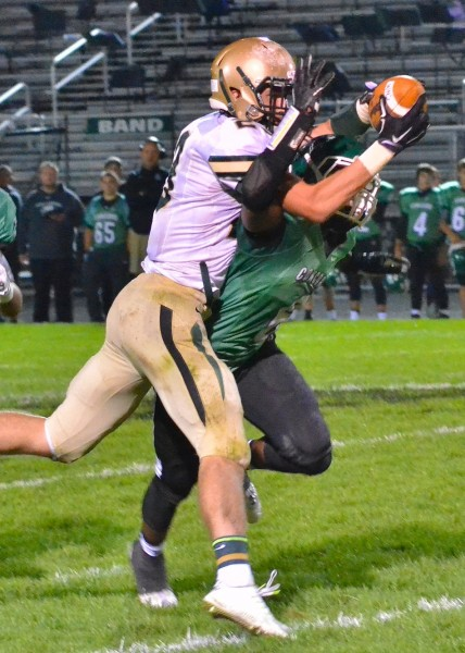 Wawasee's Clayton Cook makes a ridiculous grab around Concord defender Brandon Thomas on Friday night. (Photos by Nick Goralczyk)