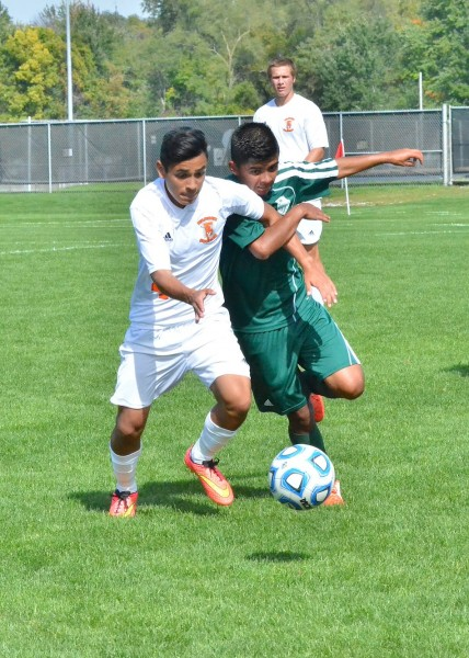Warsaw's Joaquin Juarez (left) and Luis Camargo show that there is no love lost between these two teams with their physical style of play.