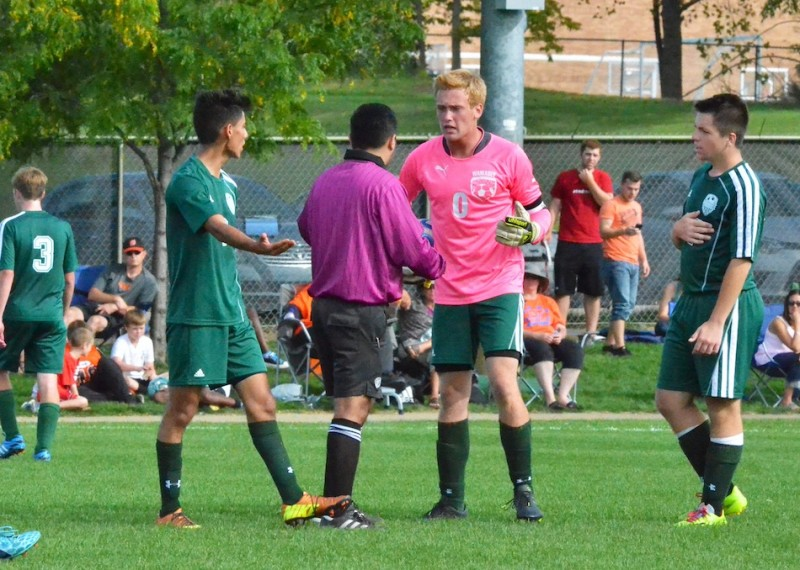 Wawasee keeper Korey Knafel (center with ball) argues with the head official after Warsaw scored the game's lone goal on Saturday afternoon. (Photos by Nick Goralczyk)