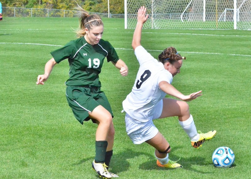 Leigh-Ann Schrack gets physical with Warsaw's Rachel McClelland.