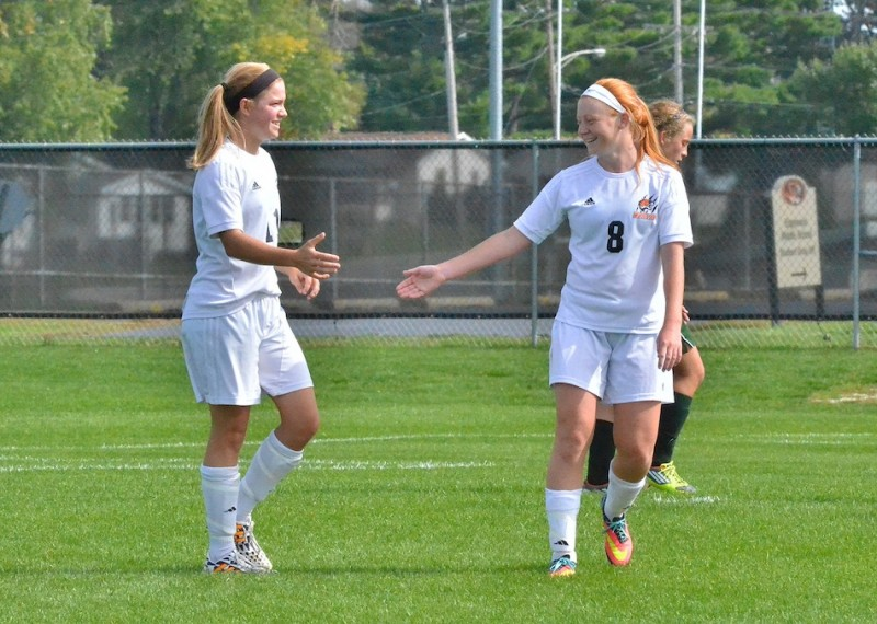 Megan Kratzsch (left) congratulates Brooklyn Jackson (right) on her first of two goals against Wawasee. (Photos by Nick Goralczyk)