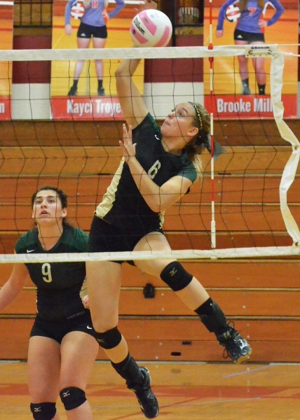 Meghan Fretz goes up for one of her seven kills on the night. (Photos by Nick Goralczyk)