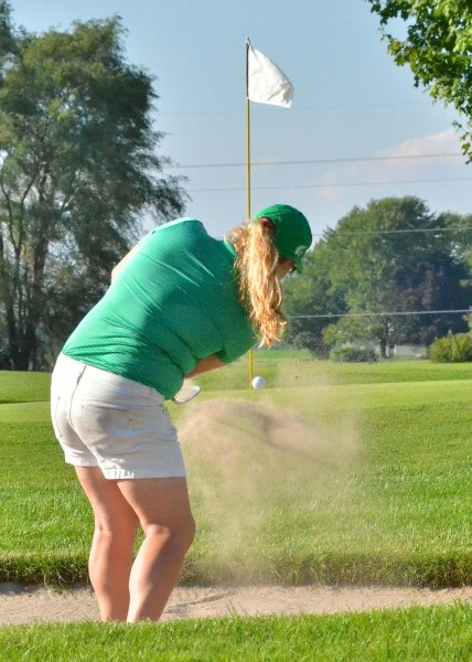 Michaela Searer hits out of the sand for Concord.