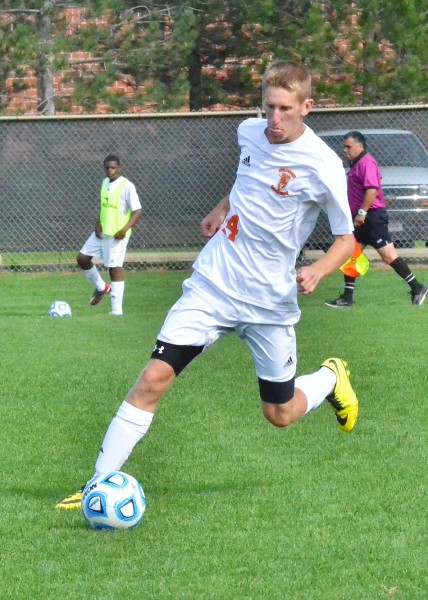 Zach Lewis looks to clear this ball for the Tigers in Saturday's contest against Wawasee.