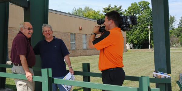 Jon Sroufe, left, shares a laugh with Gordy Young and Kelsy Zumbrun in front of the North Webster Community Center. (Photo by Martha Stoelting)