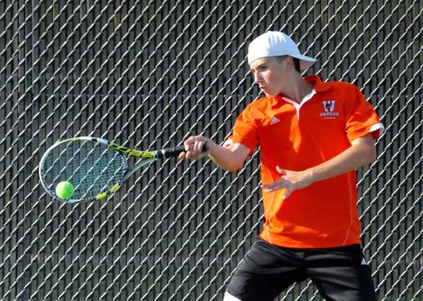 Warsaw's Cole Baker hits a shot at No. 1 doubles action  at the NLC Tourney (File photos by Mike Deak)
