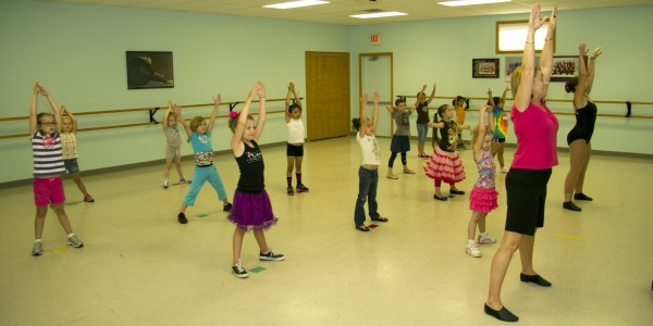 Pictured are Intro to Dance students with instructor Deb Collier.