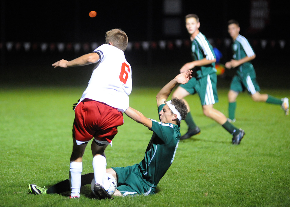 This slide tackle by Wawasee's Addison Dumford on Goshen's JT Plavchak was whistled as a penalty, which Plavchak converted for the lone goal of a 1-0 Goshen win Tuesday night. (Photos by Mike Deak)
