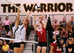 Plymouth's Haley Harrell sends up one of her 33 assists that helped Plymouth defeat Wawasee, 3-2, Thursday night. (Photos by Mike Deak)