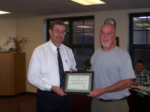 TVSC Superintendent Brett Boggs presenting Duane Hackworth with a framed certificate of recognition. (Photo provided)