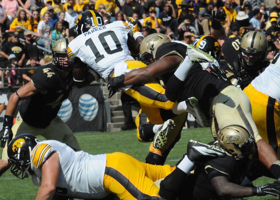 Iowa running back Jonathan Parker is swallowed up by the Purdue defense. Parker and the Hawkeyes would have the last laugh, rallying to beat Purdue 24-10 Saturday afternoon at Ross-Ade Stadium. (Photos by Dave Deak)