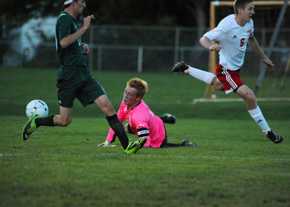 Wawasee goalkeeper Korey Knafel lays out to snuff out a shot attempt by Goshen's JT Plavchak.