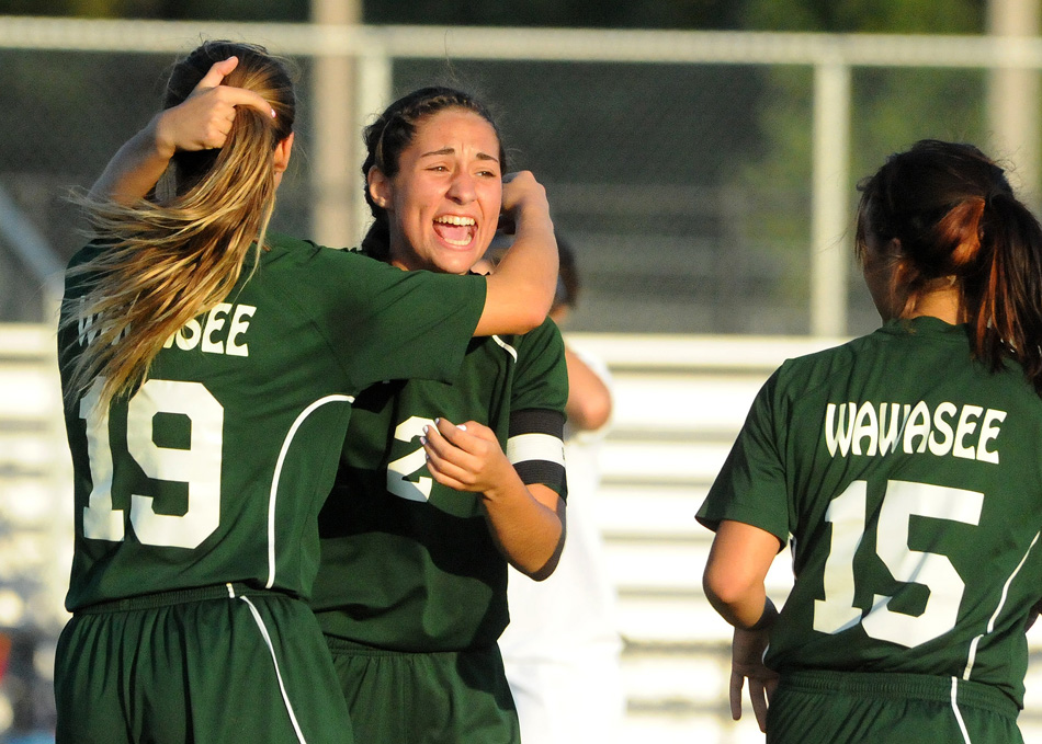 Wawasee's Sarah Lancaster celebrates with Leigh-Ann Shrack (19) and Jannette Schmidt (15) after scoring the only goal of a 1-0 win at Whitko Monday night. (Photos by Mike Deak)