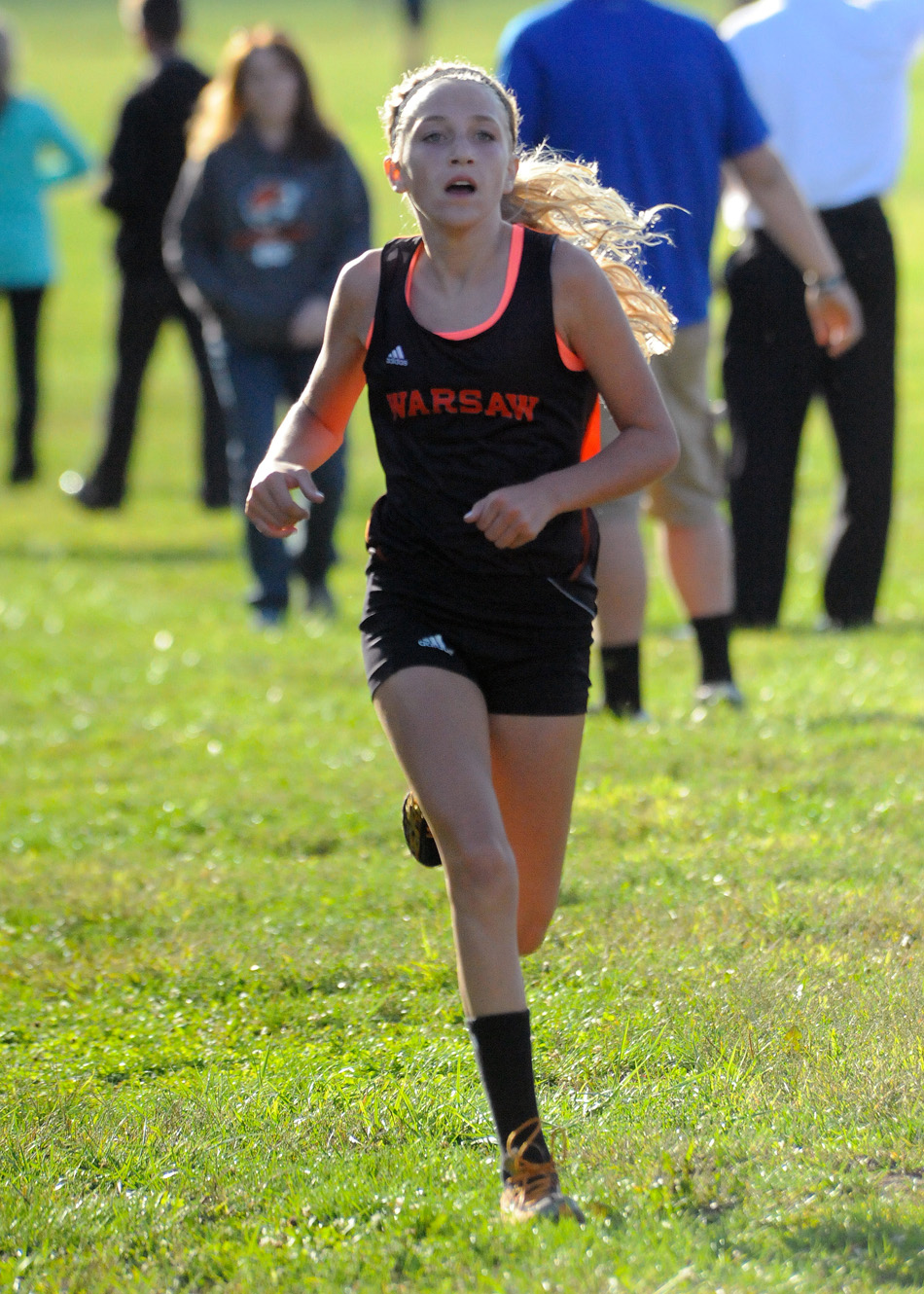 Warsaw's Mia Beckham was the best of the bunch Tuesday in the dual with Wawasee, winning with a time of 20:11. (Photos by Mike Deak)