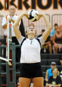 Wawasee setter Alli Ousley loads up for one of her 24 assists.