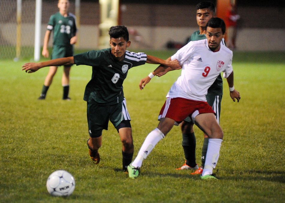 Wawasee's Ricky Camargo battles with Goshen's Kevin Garcia for possession.