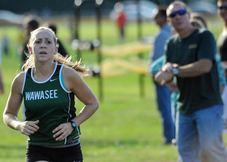 Wawasee's Sarah Harden races to the finish while dad Greg Harden keeps track of her time.