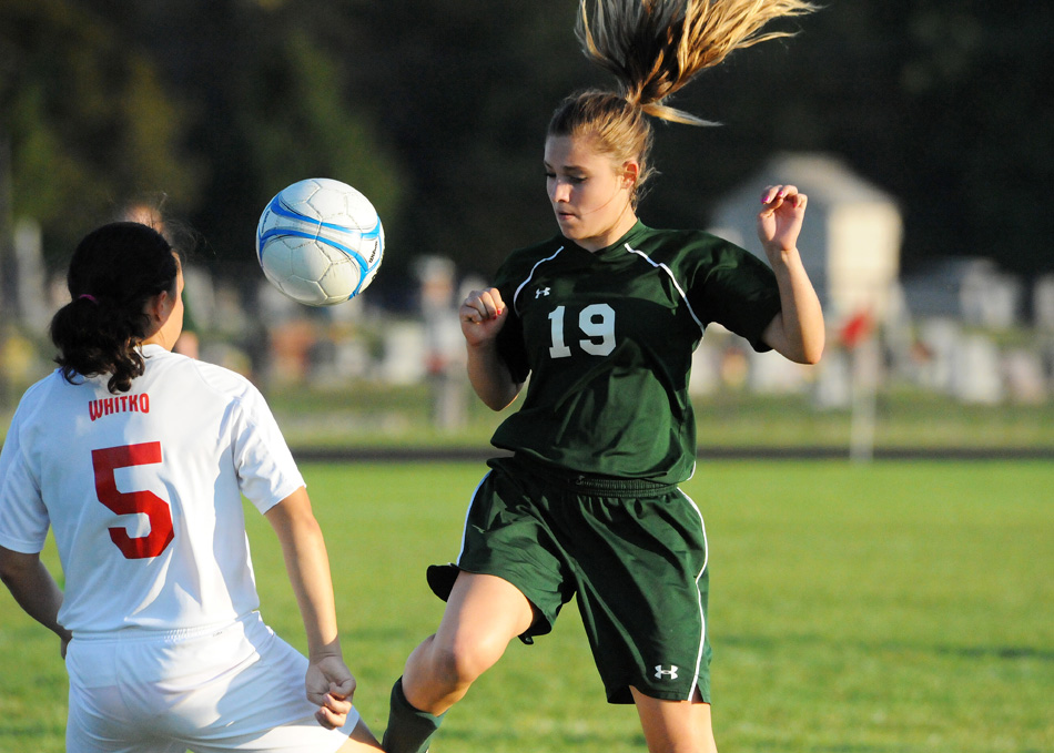 Wawasee's Leigh-Ann Shrack works for possession of the ball against Whitko's Abby Overmeyer.