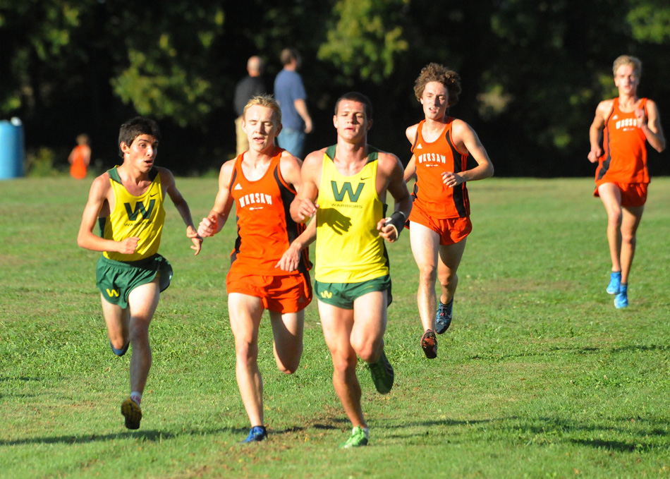 Wawasee's Troy Carolus takes a look at where Warsaw's Daniel Messenger and Wawasee's Zach Cockrill during Tuesday night's race at Wawasee. Carolus won the race at 17:18, his first-ever cross country win. (Photos by Mike Deak)