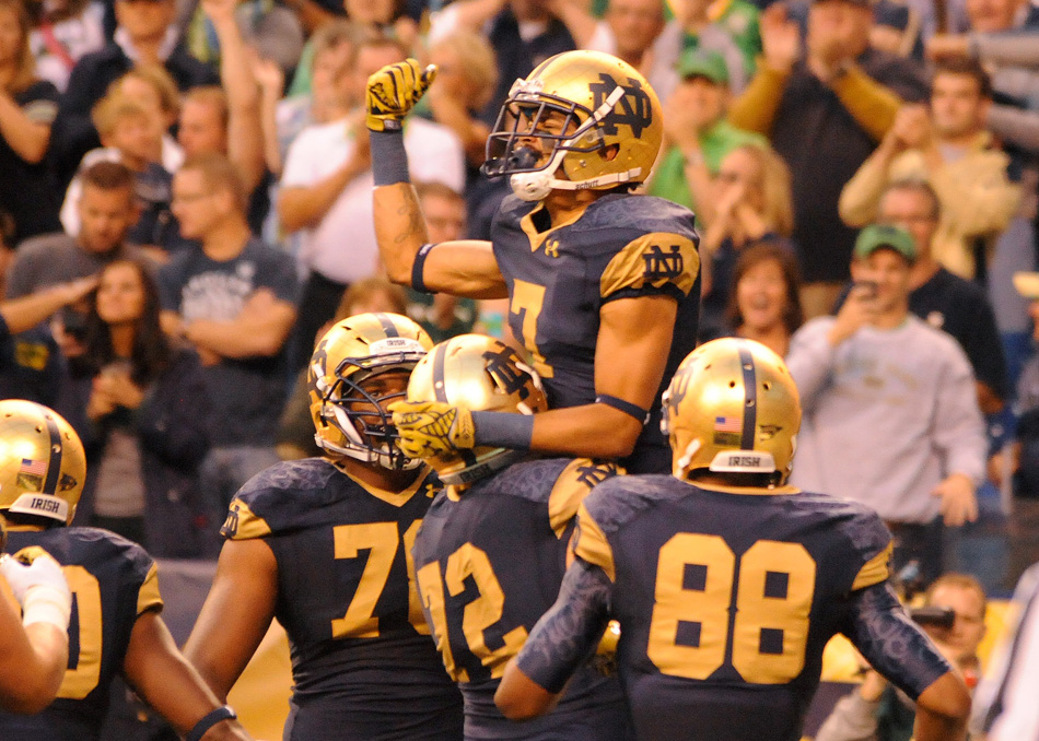 Notre Dame receiver Will Fuller celebrates after scoring a touchdown against Purdue Saturday night at Lucas Oil Stadium in the 2014 Shamrock Series game, won by Notre Dame 30-14. (Photos by Mike Deak)