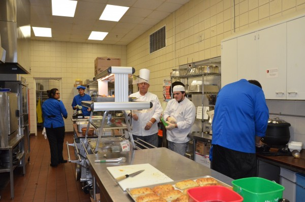 Students in the WACC Blue Apron culinary arts program work to prepare food orders from their first customers of a soft-opening held yesterday.  (Photo by Alyssa Richardson)