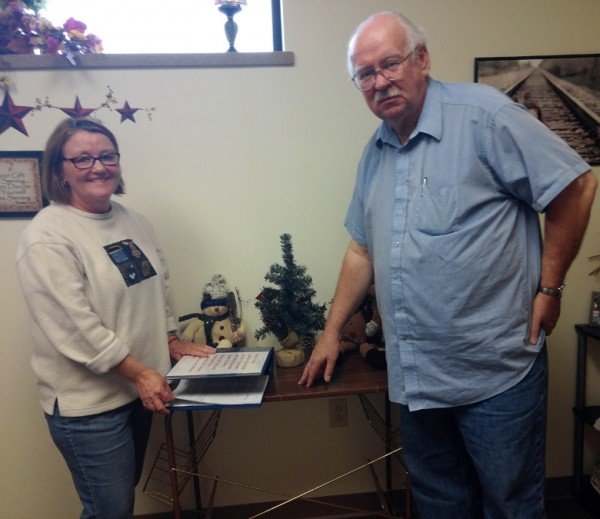 Peggy Lisenbee-Wright and Bill Leslie prepare to accept applications for the 2014 Adopt-A-Family Program at Combined Community Services. (Photo by Deb Patterson)