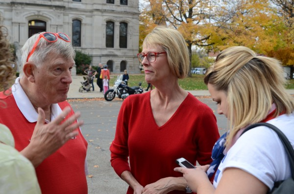 John Elliott talks with State Auditor Suzanne Crouch and Brittany McMurray, Crouch's campaign manager, during a stop in Warsaw. (Photo by Deb Patterson)