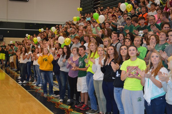 Senior and junior Wawasee High School students look up as the band plays the school fight son during the pep rally Friday.