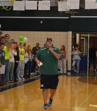 Wawasee football coach Josh Ekovich addresses the student body during the pep rally Friday afternoon.