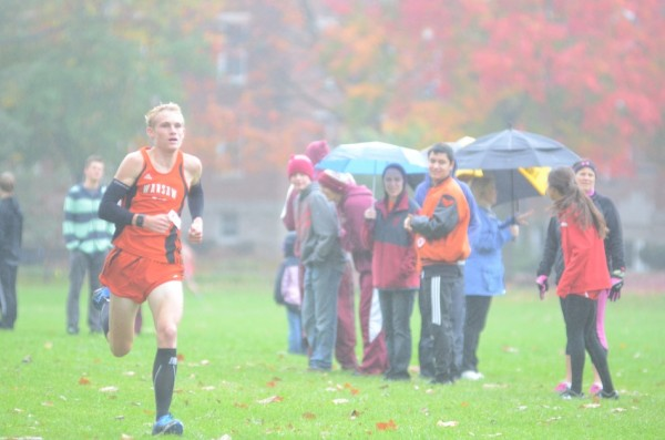 Owen Glogovsky was third overall to lead the Tigers to a title Saturday.