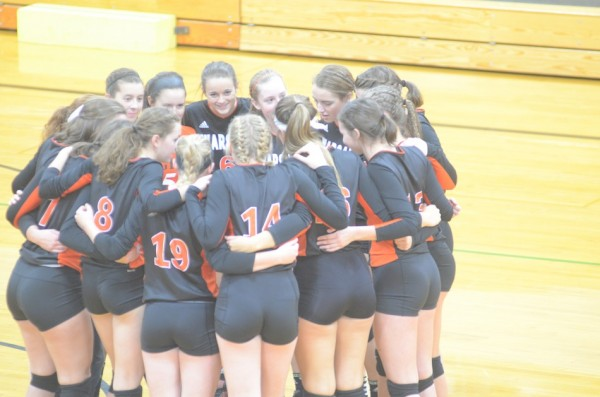 The Warsaw volleyball team gathers together just prior to its sectional opener at Concord Thursday night. The Tigers rolled past Elkhart Central 3-0.