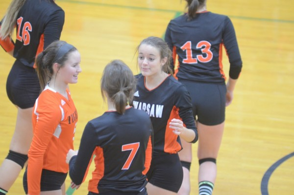 Warsaw players celebrate during sectional action.