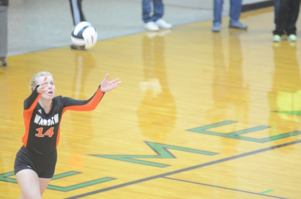 Katie Voelz prepares to serve in sectional play Thursday night. The Warsaw senior standout saw her prep career come to an end Saturday.