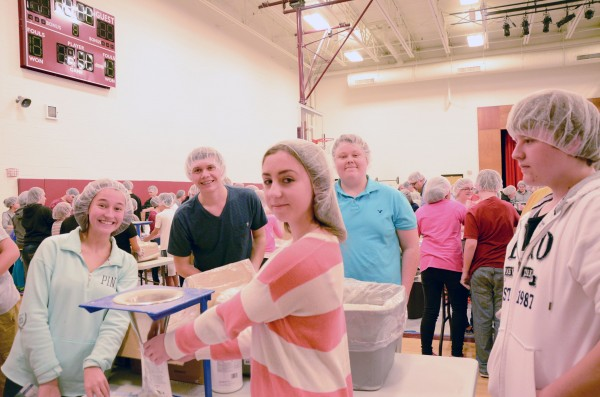 (From left) Chloe Helser, WCHS 10th grade; Hunter Haines, WCHS 10th grade; Brayden Sammons, WCHS 10th grade; Emma Manns, Edgewood Middle School eighth grade; and McKibben Lohse, Edgewood Middle School, eighth grade work to package meals as a team.  (Photo by Alyssa Richardson)