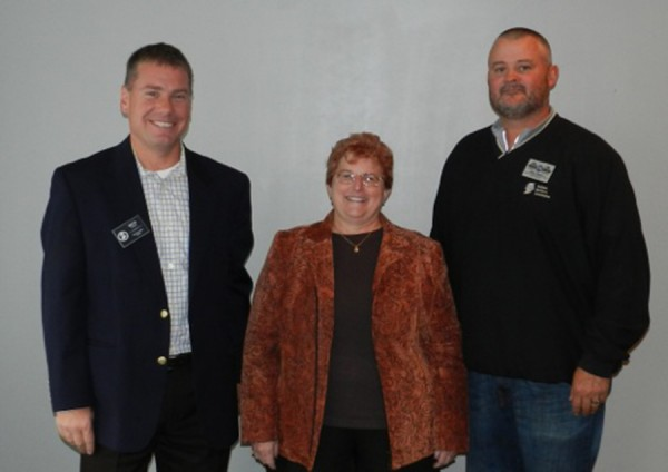 Rick Wajda, Indiana Builders Association Chief Executive Officer, congratulates Joni Truex, Builders Association Kosciusko Fulton Counties Executive Officer, and BAKFC Board President Brett Harter CGP, Freeman & Harter Custom Homes, and IBA Builder Area VP on earning first place in the IBA Pride of Leadership Contest.