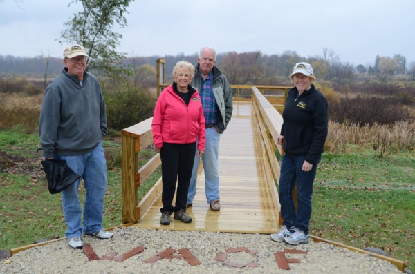 At the new overlook are Sam Lemen, WACF chairman, Barb and Doug Grant and Heather Harwood, WACF executive director. An informational board will be added to the location in the future. (Photo by Deb Patterson)