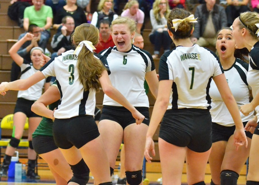 Ashley Beer (5) and the Lady Warriors celebrate a point later in game two against NorthWood. (Photos by Nick Goralczyk)