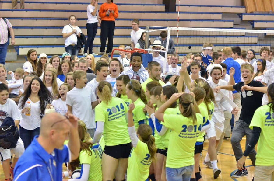 Blackhawk students storm the court following their team's 3-0 sweep of Triton in the regional championship Tuesday night. (Photos by Nick Goralczyk)