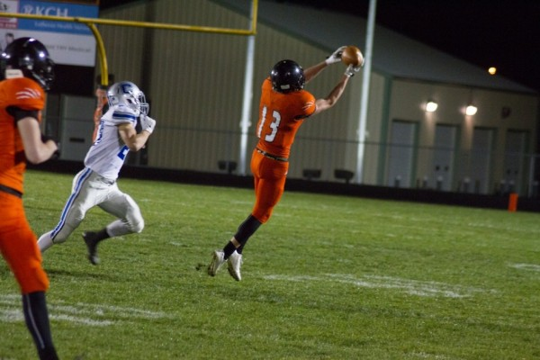 Receiver Brock Riley hauls in a pass for Warsaw.