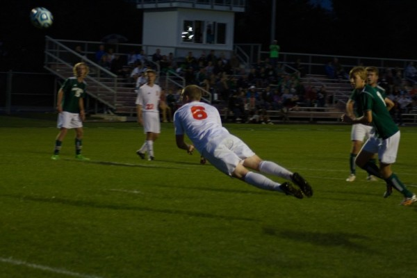 Sam Allbritten dives for a header for the Tigers.