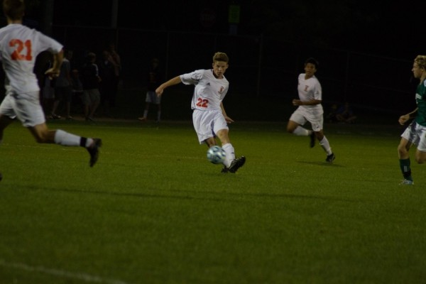 Justice Voss blasts the ball for Warsaw Thursday night during a 5-0 home loss to Northridge (Photos by Ansel Hygema)