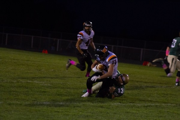 Brock Riley is tackled after making a reception for the Tigers.