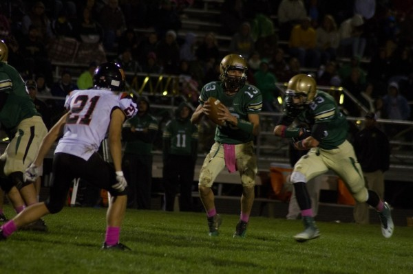 Gage Reinhard loos to pass for Wawasee Friday night. Reinhard had a huge game to help the Warriors top Warsaw 21-10 in Syracuse (Photos by Ansel Hygema)