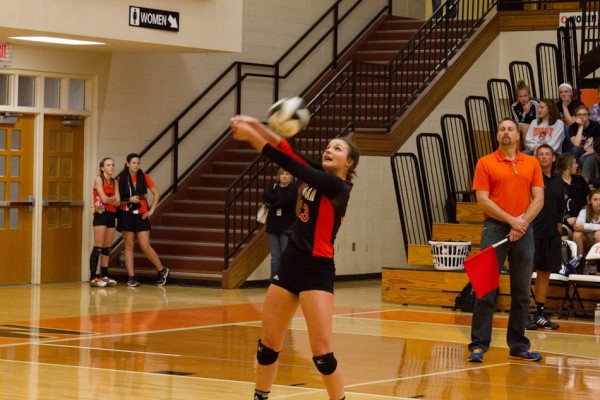 Caroline Mayer passes the ball for the Tigers Monday night.