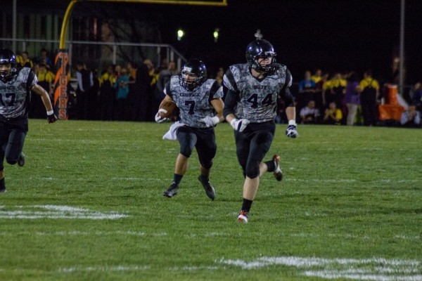 Ethyn Bradley returns an interception for Warsaw Friday night. The Tigers rallied to top Concord 24-21 in double overtime (Photo by Ansel Hygema)