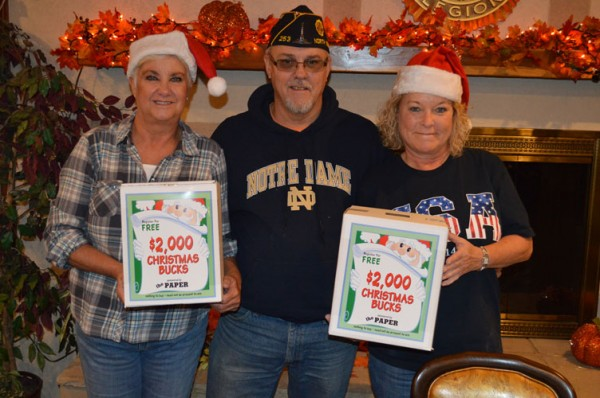 Jody Burkhart, left, Jeff Spickelmier (commander) and Candice Hine of the North Webster American Legion Post 253 are ready for the annual Christmas Bucks promotion. (Photo by Tim Ashley)