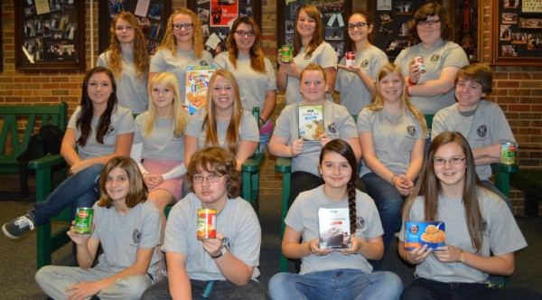 It's time for the annual Wawasee High School Key Club Stuff The Bus food drive. Seated on the ground, from left, are Key Club members Olivia Long, Christian Schmidt, Katie Kuhn and Ashleigh Frecker. In the middle row are Kinzie Wilson, Brianne Willis, Logan Dickerson, Paige Smiley, Amanda Foy and Zach Hunter. In the back row are Taylor Freel, Hunter Dolsen, Lexy Green, Kamryn Foy, Riley Johnston and Kassidy Bowman. Not pictured are Shae Henn and Ally Kuhn.